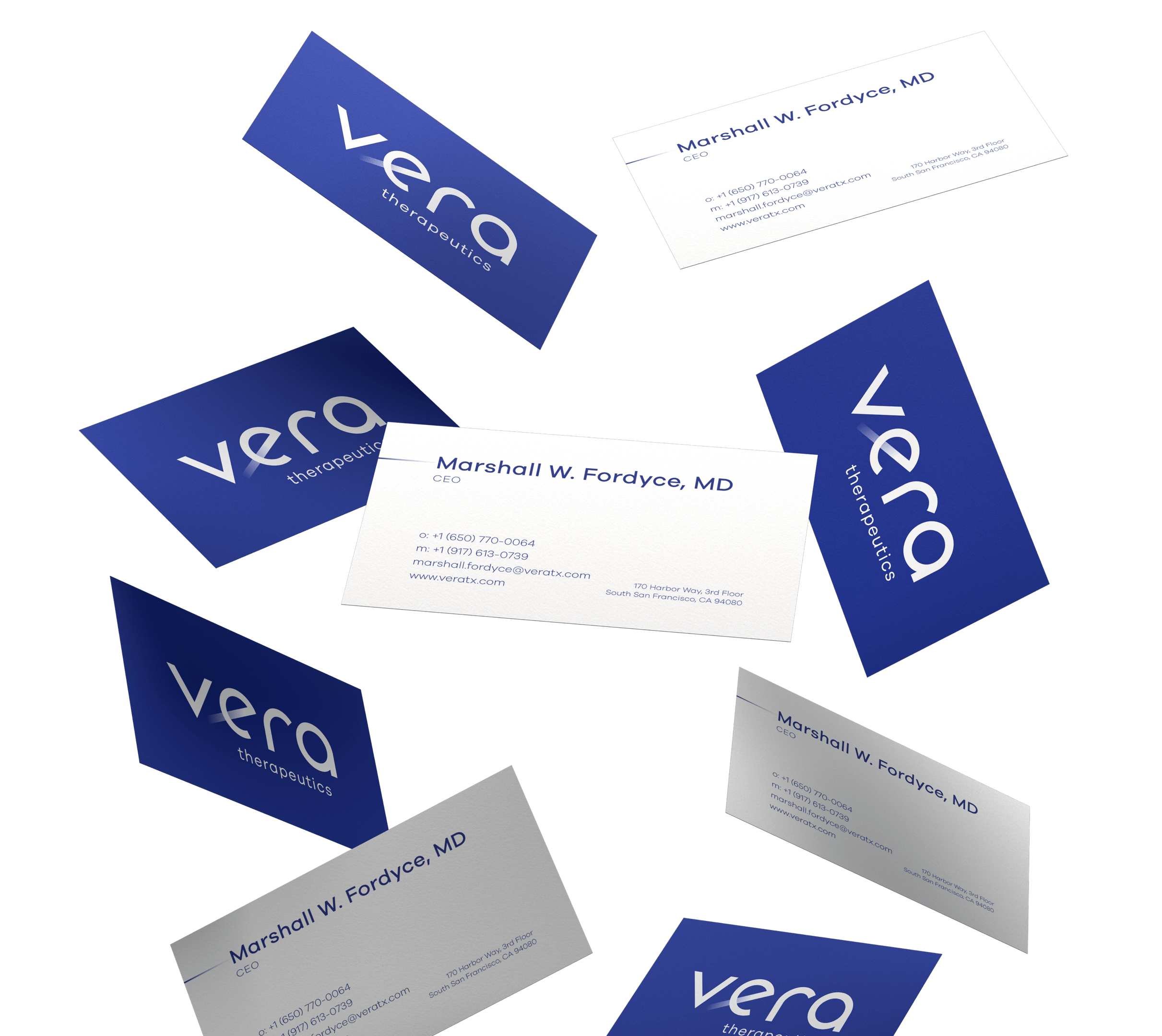 several blue and white Vera business cards floating in the air